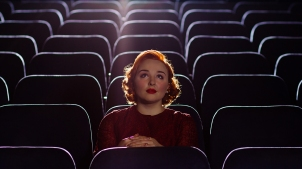 woman_alone_in_cinema_gettyimages-170468370-1